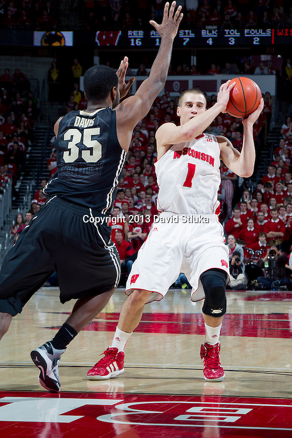 Wisconsin Badgers guard Ben Brust (1) handles the ball during a Big Ten Conference NCAA college basketball game against the Purdue Boilermakers Sunday, March 3, 2013, in Madison, Wis. Purdue won 69-56. (Photo by David Stluka)