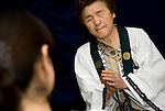 "Take Nakamura, 79, one of Japan's few remaining ""itako"" (a kind of shaman) calls on the spirits of a deceased relative of client in Hachinohe City, Aomori Prefecture Japan on 03 Sept. 2011. Photograph: Robert Gilhooly"