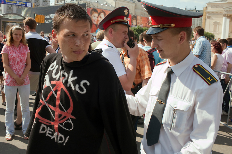 Moscow, Russia, 12/06/2010..An anarchist who threw a flare is arrested at a rally of the pro-Kremlin youth group Young Russia during a Young Russia event and concert to mark the Russia Day national holiday.