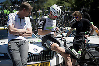 Bernie Eisel (AUT/Dimension Data) fine-tuning his shoes before the start with 'Head of Performance' Rolf Altag<br /> <br /> stage 15: Bourg-en-Bresse to Culoz (160km)<br /> 103rd Tour de France 2016