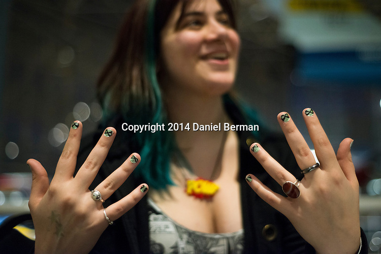 Rin Venieris of Seattle got her nails painted with Captain Marvel icons by Christal VanEtten of Espionage Cosmetics from Bellingham, Wash. during the Carol Corps Celebration Thursday March 27, 2014 at the Museum of Flight in Seattle. Held the day before Emerald City Comicon kicked off, the event raised funds for Girls Leadership Institute and offered a chance for fans to meet and chat with Captain Marvel writer Kelly Sue DeConnick and Ms. Marvel writer G. Willow Wilson. Photo by Daniel Berman for WIRED.com