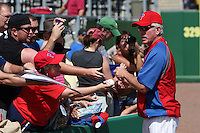 Philadelphia Phillies coach Mike Schmidt signs autographs before a scrimmage against the Florida State Seminoles at Brighthouse Field on February 29, 2012 in Clearwater, Florida.  Philadelphia defeated Florida State 6-1.  (Mike Janes/Four Seam Images)