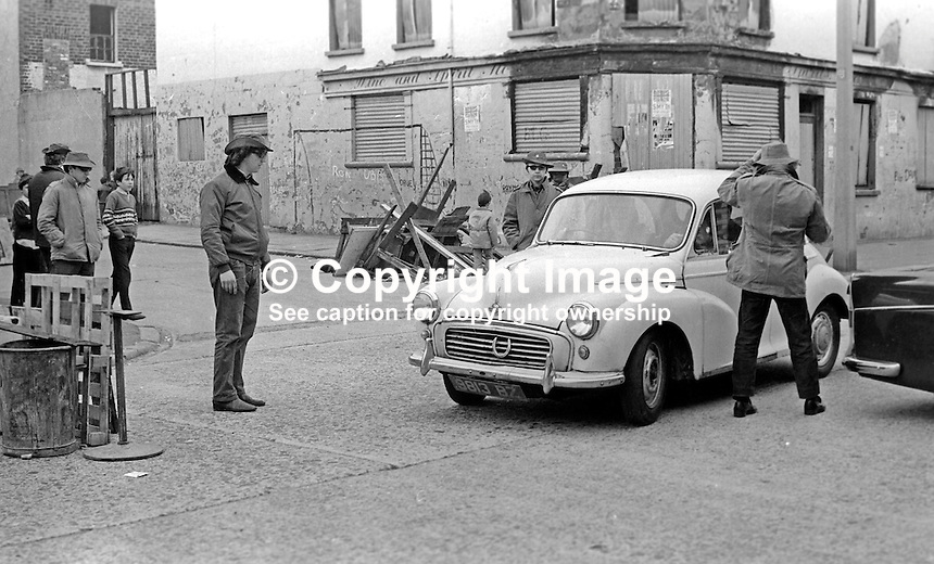 Masked members of the loyalist para-military Ulster Defence Association operating a vehicle checkpoint in the predominently Protestant Woodvale district of Belfast, N Ireland, UK, on 14th May 1972. 197205140563b<br />