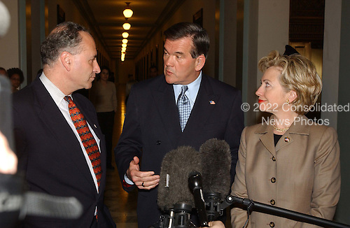 Washington, DC - March 20, 2002 -- United States Director of Homeland Security Tom Ridge, center, meets with U.S. Senator Hillary Rodham Clinton (Democrat of New York), right, in her Capitol Hill Office.  They were joined by U.S. Senator Chuck Schumer (Democrat of New York), left..Credit: Ron Sachs / CNP