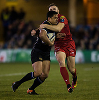 Bath Rugby's Ben Tapuai is tackled by Scarlets&rsquo; Tom Prydie<br /> <br /> Photographer Bob Bradford/CameraSport<br /> <br /> European Champions Cup Round 5 - Bath Rugby v Scarlets - Friday 12th January 2018 - The Recreation Ground - Bath<br /> <br /> World Copyright &copy; 2018 CameraSport. All rights reserved. 43 Linden Ave. Countesthorpe. Leicester. England. LE8 5PG - Tel: +44 (0) 116 277 4147 - admin@camerasport.com - www.camerasport.com