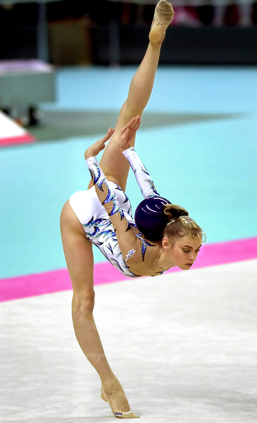 2 OCTOBER 1999 - OSAKA, JAPAN: Yulia Barsoukova of Russia performs with ball at the 1999 World Championships in Osaka, Japan. Yulia won bronze in the women's all around and went onto to become 2000 Olympic champion in rhythmic gymnastics.