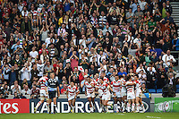 The Japan team celebrate a second half try by Ayumu Goromaru. Rugby World Cup Pool B match between South Africa and Japan on September 19, 2015 at the Brighton Community Stadium in Brighton, England. Photo by: Patrick Khachfe / Onside Images