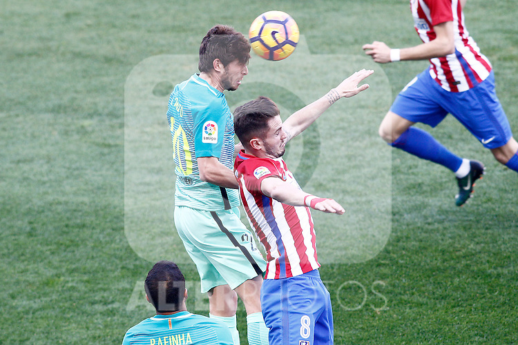 Atletico de Madrid's Saul Niguez (r) and FC Barcelona's Sergi Roberto during La Liga match. February 26,2017. (ALTERPHOTOS/Acero)