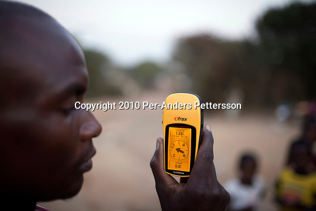 LUSAKA, ZAMBIA - JUNE 15: Moses Mndhlovu, age 29, a field officer tracks stoves with a GPS. Cook stoves supplied by (CDM) Clean Development Mechanism  are all tracked an monitored by GPS on June 15, 2010, in Lusaka, Zambia.  CDM is one of the mechanisms in article 12 in the Kyoto Protocol that allows industrial nations to meet their CO2 emission reduction targets by investment and transfer of sustainable technologies in development countries. In Zambia, Lusaka Sustainable Energy project , is providing house-holds with cook stoves, financed by RWE Power AG, the German power utility. The project in Zambia seeks to switch charcoal consuming households to sustainable harvested sticks of wood used for the cookers, and by doing that saving trees and the environment in Zambia. House-holds are save a substantial amount of money every month by not buying charcoal, which usually is a major cost for poor people in the country. (Photo by Per-Anders Pettersson/Getty Images)