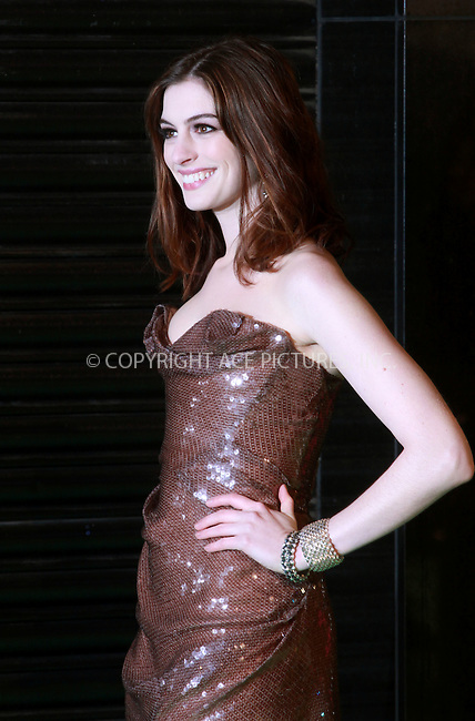 """WWW.ACEPIXS.COM . . . . .  ..... . . . . US SALES ONLY . . . . .....February 25 2010, New York City....Anne Hathaway at the UK premiere of """"Alice in Wonderland"""" on February 25 2010 in London......Please byline: FAMOUS-ACE PICTURES... . . . .  ....Ace Pictures, Inc:  ..tel: (212) 243 8787 or (646) 769 0430..e-mail: info@acepixs.com..web: http://www.acepixs.com"""