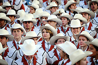 Jan 7, 2010; Pasadena, CA, USA; The Texas Longhorns marching band watches pregame warm-ups before the 2010 BCS national championship game against the Alabama Crimson Tide at the Rose Bowl.  Mandatory Credit: Mark J. Rebilas-