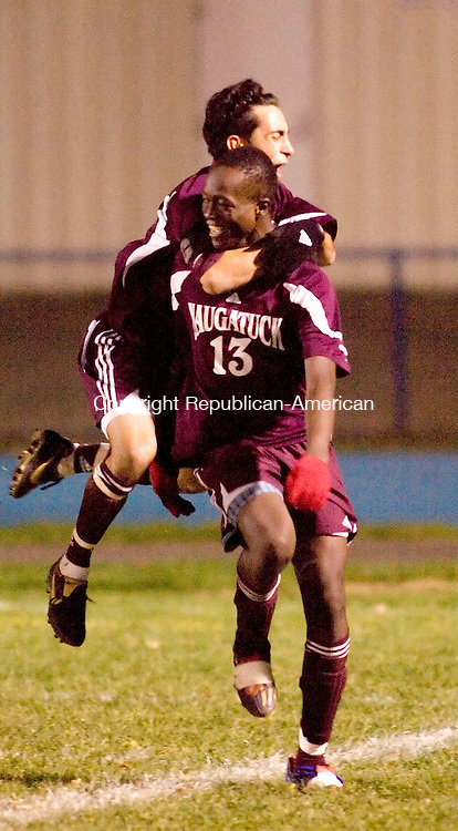 SEYMOUR, CT-25 OCTOBER 2006-102506JS02-Naugatuck's Shawn Teixeira hugs teammate Manuel Nanadoum after Manuel scored the teams second goal in their 2-0 win over Seymour. With the win, Naugatuck clinched the NVL title. <br />  -Jim Shannon Republican-American