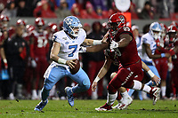 RALEIGH, NC - NOVEMBER 30: Sam Howell #7 of the University of North Carolina is sacked by Alim McNeill #29 of North Carolina State University during a game between North Carolina and North Carolina State at Carter-Finley Stadium on November 30, 2019 in Raleigh, North Carolina.