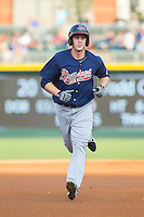 Todd Cunningham (20) of the Gwinnett Braves rounds the bases after hitting a home run against the Charlotte Knights at BB&T Ballpark on August 6, 2014 in Charlotte, North Carolina.  The Knights defeated the Braves  12-10.  (Brian Westerholt/Four Seam Images)