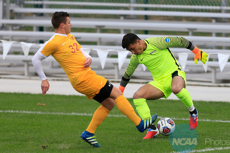 KANSAS CITY, MO - DECEMBER 03:  Pablo Jara (1) of Wingate University and Will Roberts (32) of the University of Charleston battle for the ball during the Division II Men's Soccer Championship held at Children's Mercy Victory Field at Swope Soccer Village on December 03, 2016 in Kansas City, Missouri. Wingate beat Charleston 2-0 to win the National Championship. (Photo by Jack Dempsey/NCAA Photos via Getty Images)
