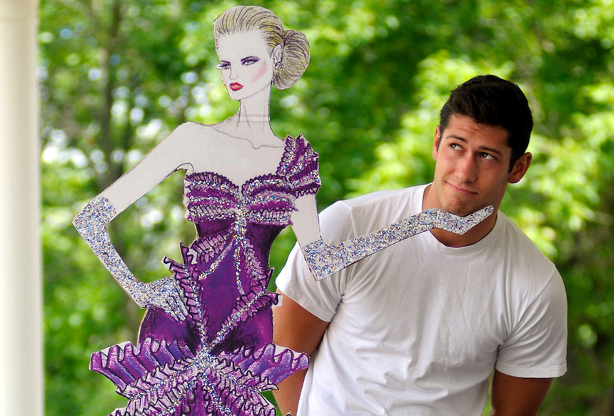 Nathan Braun, a Pius XI graduate, poses with a large, blown-up version of a freehand gown design at his Brookfield home on Monday, June 29, 2009. He created the drawing for a class project art portfolio He had the drawing enlarged at a copy print center. The original drawing is at Pius. The drawing helped earn him a scholarship at the Fashion Institute of Design and Merchandising in Los Angeles. Ernie Mastroianni photo.