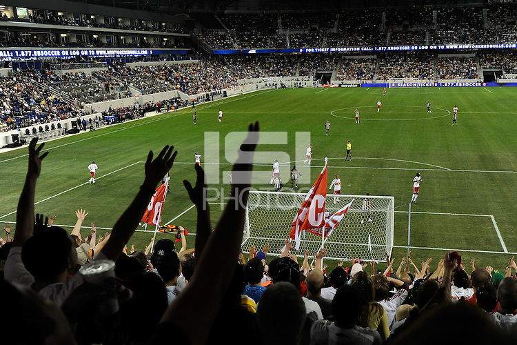 Fans react to a play during the second half of a friendly between Sanots FC and the New York Red Bulls at Red Bull Arena in Harrison, NJ, on March 20, 2010. The Red Bulls defeated Santos FC 3-1.