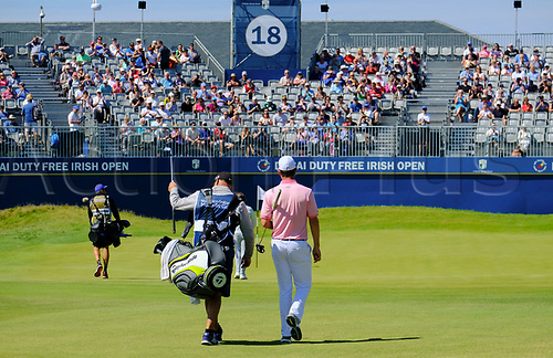 July 8th 2017, Portstewart Golf Club, Portstewart, Northern Ireland; Dubai Duty Free Irish Open Golf Championship, Day 3; Justin Rose (ENG) makes his way down the fairway towards the 18th hole during the third round of the Dubai Duty Free Irish Open; Rose sitting on -13 at end of 3rd round