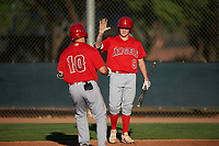 AZL Angels Justin Kunz (10) is congratulated by Spencer Brown (9) after hitting a home run during an Arizona League game against the AZL D-backs on July 20, 2019 at Salt River Fields at Talking Stick in Scottsdale, Arizona. The AZL Angels defeated the AZL D-backs 11-4. (Zachary Lucy/Four Seam Images)