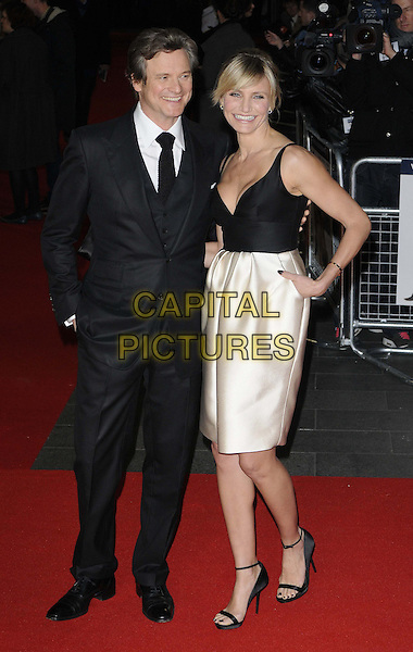 Colin Firth & Cameron Diaz.'Gambit' world film premiere Empire cinema, Leicester Square, London, England..7th November 2012.full length top silk satin white skirt clutch bag open to ankle strap sandals black low cut neckline cleavage clutch bag  suit shirt tie hand in pocket smiling.CAP/CAN.©Can Nguyen/Capital Pictures.