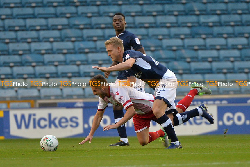 Millwalls George Saville and Stevenage's Tom Pett tackle  during Millwall vs Stevenage, Caraboa Cup Football at The Den on 8th August 2017