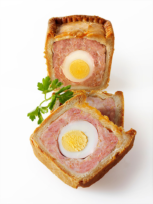 Traditional pork pie with an egg in the middle stock photos. Melton Mobray Pie