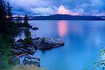 Idaho, Coeur d'Alene, Lake Coeur d'Alene. Twilight shoreline view of Tubbs HIll nature park.