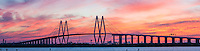 This is the Fred Hartman Bridge panorama outside of  Houston which runs across the ship channel between Baytown and La Porte Texas. This is a very long bridge which runs about 2.6 miles.  On this day we had been in the area and decided to go see if we could capture it and boy did we get an incredible sunset. This bridge replaced the Baytown tunnel which went under the water because they need it to be deeper,  As a child we would drive through the tunnel and I was alway scare it would collapse on us. Watermark will not appear on image