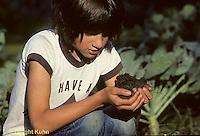 HS10-001z  Girl looking at garden soil