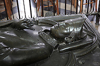 Tomb of Geoffroy d'Eu, bishop of Amiens, died 1236, in single-cast bronze, 13th century, in the nave of the Basilique Cathedrale Notre-Dame d'Amiens or Cathedral Basilica of Our Lady of Amiens, built 1220-70 in Gothic style, Amiens, Picardy, France. His hand is raised in a gesture of blessing. Amiens Cathedral was listed as a UNESCO World Heritage Site in 1981. Picture by Manuel Cohen