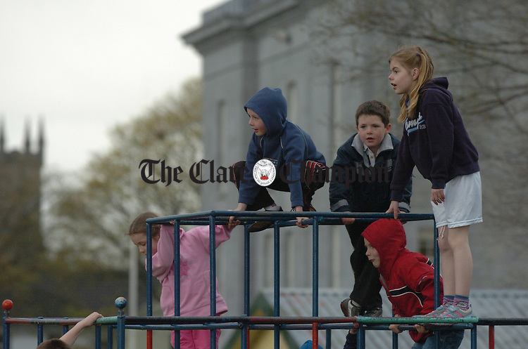 The climbing frame in the Fair Green made a good vantage point for these children during the Ennis Community Games athletics finals. Photograph by John Kelly.