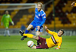 Motherwell v St Johnstone...10.11.10  .John Sutton slides in on Steven Anderson.Picture by Graeme Hart..Copyright Perthshire Picture Agency.Tel: 01738 623350  Mobile: 07990 594431