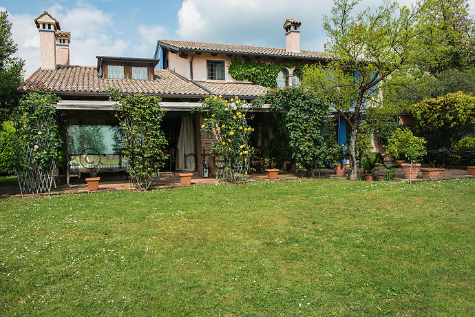 The traditional exterior of Michela Goldschmied's home in Asolo belies the surprise of its multi-coloured lively interior