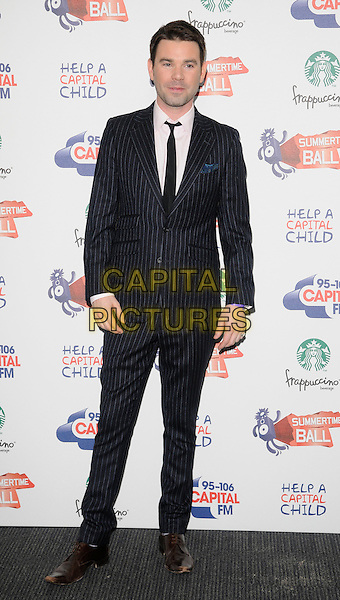 DAVE BERRY.The Capital FM Summertime Ball, Wembley Stadium, London, England..June 12th, 2011.full length black pinstripe suit tie white shirt.CAP/CAN.©Can Nguyen/Capital Pictures.