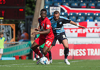 David Tutonda of York City holds off Paul Hayes of Wycombe Wanderers during the Sky Bet League 2 match between Wycombe Wanderers and York City at Adams Park, High Wycombe, England on 8 August 2015. Photo by Andy Rowland.