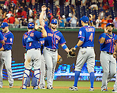 New York Mets left fielder Kirk Nieuwenhuis (9) celebrates his team's 8-7 victory over the Washington Nationals with teammates New York Mets catcher Travis d'Arnaud (7) and New York Mets shortstop Wilmer Flores (4) at Nationals Park in Washington, D.C. on Tuesday, September 8, 2015.  The Mets won the game 8-7.<br /> Credit: Ron Sachs / CNP