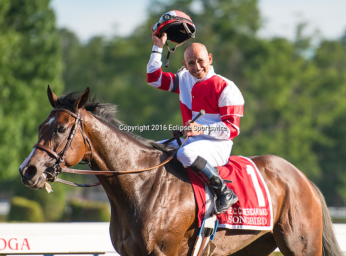 SARATOGA SPRINGS, NY - JULY 22: Songbird (no. 1), ridden by Mike Smith and trained by Jerry Hollendorfer, wins the grade 1 Coaching Club American Oaks for three year old fillies on July 24, 2016 at Saratoga Race Course in Saratoga Springs, New York. (Photo by Samantha Bussanich/Eclipse Sportswire/Getty Images