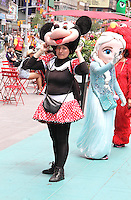 NEW YORK, NY - JUNE 21: Costumed characters in the green zone on the first day of NYPD (New York Police Department) enforcement of the new pedestrian zones in Times Square where costumed characters and those selling bus or show tickets are required to solicit only in the designated green zone in New York, New York on June 21, 2016.  Photo Credit: Rainmaker Photo/MediaPunch