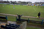 A home fan celebrating as Port Talbot Town (in blue) score against Caerau Ely in a Welsh Cup fourth round tie at the Genquip Stadium, formerly known as Victoria Road. Formed by exiled Scots in 1901 as Port Talbot Athletic, they competed in local and regional football before being promoted to the League of Wales  in 2000 and changing their name to the current version a year later. Town won this tie 3-0 against their opponents from the Welsh League, one level below the welsh Premier League where Port Talbot competed, watched by a crowd of 113.