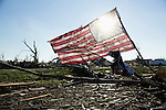 American flag in debris after tornado