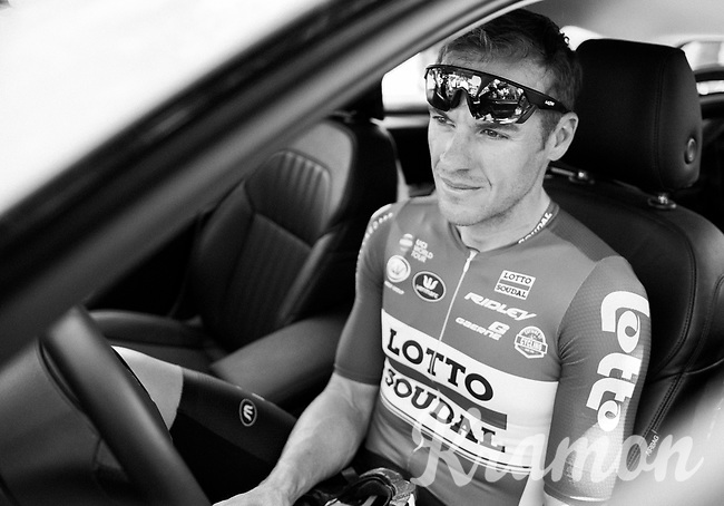 a relaxed Adam Hansen (AUS/Lotto-Soudal) in the teamcar at the stage start in the tiny birth town of Fausto Coppi: Castellania as team buses weren't allowed up<br /> <br /> 100th Giro d'Italia 2017<br /> Stage 14: Castellania &rsaquo; Oropa (131km)