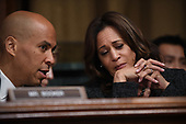 US Senators Cory Booker (L) and Kamala Harris (R) chat as Christine Blasey Ford, the woman accusing Supreme Court nominee Brett Kavanaugh of sexually assaulting her at a party 36 years ago, testifies before the US Senate Judiciary Committee on Capitol Hill in Washington, DC, September 27, 2018.  / POOL / SAUL LOEB