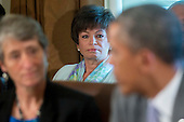 Valerie Jarrett, senior advisor to U.S. President Barack Obama, center, looks on as Obama, right, speaks during a cabinet meeting at the White House in Washington, D.C., U.S., on Tuesday, July 1, 2014. Obama said yesterday he'll go it alone on changing U.S. immigration rules because House Republicans won't act. <br /> Credit: Andrew Harrer / Pool via CNP