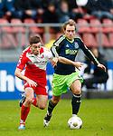 Nederland, Utrecht, 23 december 2012.Eredivisie .Seizoen 2012-2013.FC Utrecht-Ajax.Christian Eriksen (r.) van Ajax en Thomas Oar (l.) van FC Utrecht strijden om de bal.