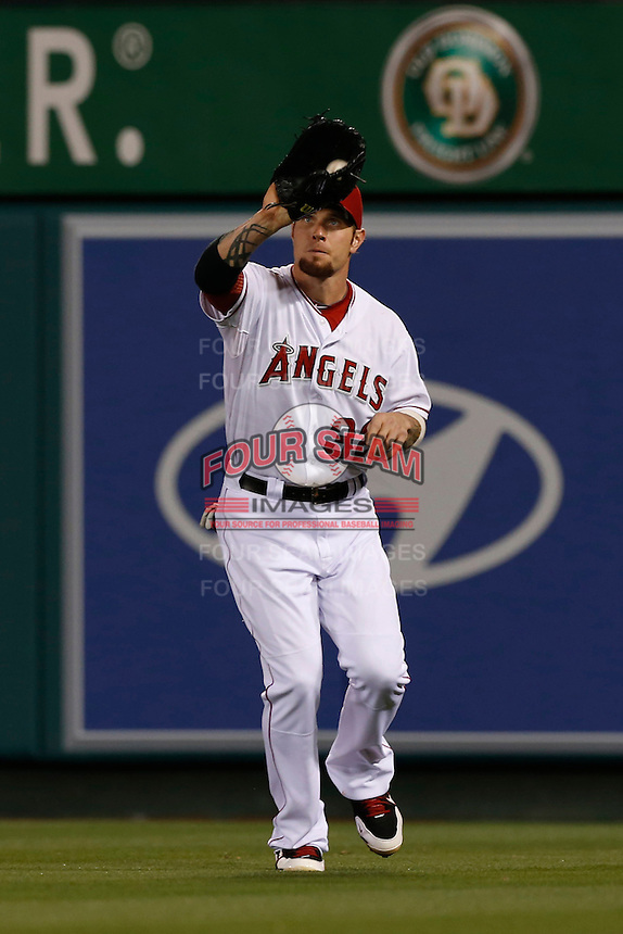 Josh Hamilton #32 of the Los Angeles Angels catches a ball in the outfield during a game against the Chicago White Sox at Angel Stadium on May 17, 2013 in Anaheim, California. (Larry Goren/Four Seam Images)