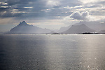 Sunshine over sea and mountain scenery Lofoten islands, Nordland, Norway