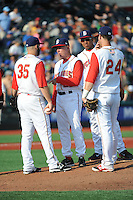Brooklyn Cyclones manager Tom Gamboa (20) talks with pitcher Dillion Gee (35) during game against the Staten Island Yankees at MCU Park on June 29, 2014 in Brooklyn, NY.  Staten Island defeated Brooklyn 5-4.  (Tomasso DeRosa/Four Seam Images)