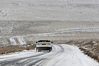 WEATHER PICTURE WALES<br /> Pictured: A car travels on the A4059 between Penderyn and Storey Arms, Brecon Beacons in south Wales, UK. Friday 02 March 2018<br /> Re: Beast from the East and Storm Emma has been affecting most parts of the UK.