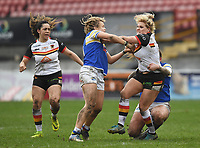 Picture by Anna Gowthorpe/SWpix.com - 15/04/2018 - Rugby League - Womens Super League - Bradford Bulls v Leeds Rhinos - Coral Windows Stadium, Bradford, England - Bradford Bulls' Amy Hardcastle is tackled by Leeds Rhinos' Lois Forcell (left) and Caitlin Beevers