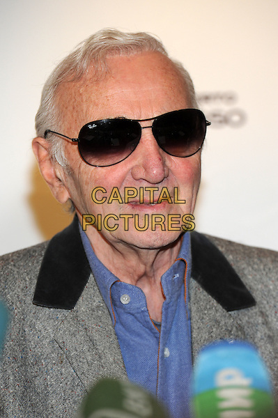 Charles Aznavour.press conference in Moscow, Russia..December 10th, 2011.headshot portrait blue shirt grey gray sunglasses shades  .CAP/PER/AL.©AL/PersonaStars/CapitalPictures